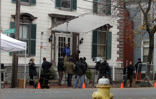 The crew for a horror movie called ÒLords of Salem, written and directed by Rob Zombie, worked through the rain to shoot on the corner of Essex and Hamilton streets yesterday afternoon. (David Le/Staff photo)