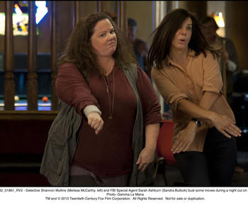 COPPING AN ATTITUDE: Melissa McCarthy, above left, and Sandra Bullock play a mismatched Boston cop and FBI agent forced to work together in 'The Heat.'