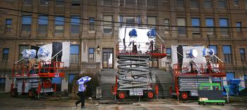 "Filmmakers shooting ""Here Comes the Boom"" at the old Quincy High School on Coddington Street train huge lights on the school to create the illusion of a sunny day, Monday, April 4, 2011. (GREG DERR/The Patriot Ledger)"