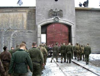 "Extras dressed as soldiers walk on the set of ""Shutter Island"" during a 2008 shoot at the Whittenton MIlls in Taunton."