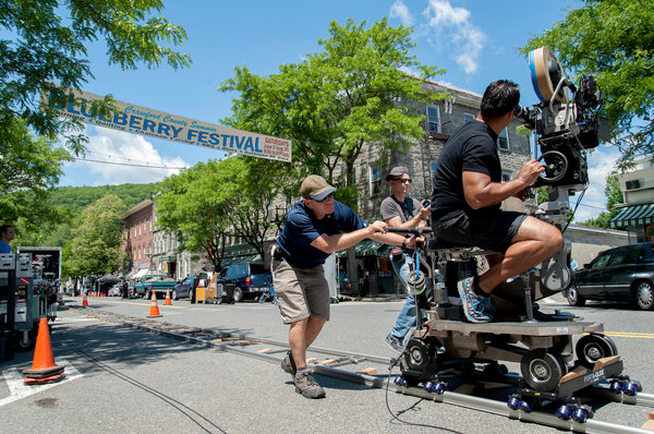 "Shelburne Falls, Mass., became a film set again this summer as cameras rolled along Bridge Street, making ""The Judge,"" a story set in Indiana.  (Nancy Palmieri for The New York Times)"