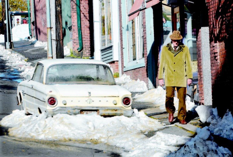 "Mike Springer photos Actor Richard Jenkins walks past piles of snow and an early 1960s-model Ford Falcon Futura while filming a scene for the HBO miniseries ""Olive Kitteridge"" yesterday on Center Street. Jenkins plays pharmacist Henry Kitteridge, husband of the title character, in the film"