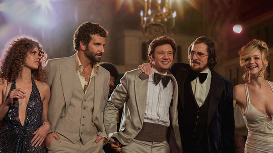 From left, Amy Adams, Bradley Cooper, Jeremy Renner, Christian Bale, Jennifer Lawrence in a scene from American Hustle.