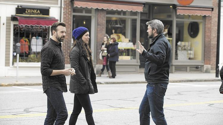 """Tumbledown"" stars Jason Sudeikis, left, and Rebecca Hall talk with director Sean Mewshaw during a film shoot in Concord, Mass. The indie movie's budget was roughly $4 million. (Seacia Pavao)"