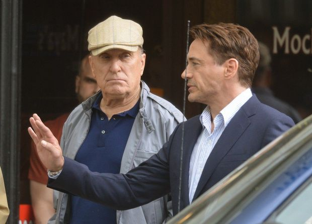 June 6, 2013 - Shelburne Falls, Mass. - Actors Robert Duvall, left, and Robert Downey Jr., in between takes on the set of The Judge, a Warner Brothers movie, in Shelburne Falls Thursday. (Michael S. Gordon /The Republican)