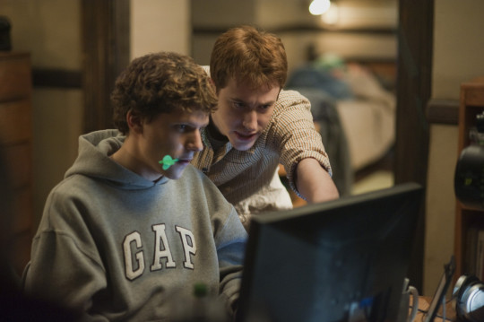 """Jesse Eisenberg, left, and Joseph Mazzello are shown in a scene from """"The Social Network."""" (Columbia Pictures, Merrick Morton/AP)"""