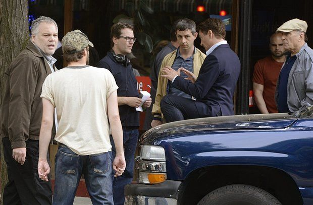 "In between takes on the set of ""The Judge"" in Shelburne Falls on June 6, 2013; from left, actor Vincent D'Onofrio, talks with an unidentified crew member, and director David Dobkin with actors Jeremy Strong, Robert Downey Jr. and Robert Duvall. (Michael S. Gordon 