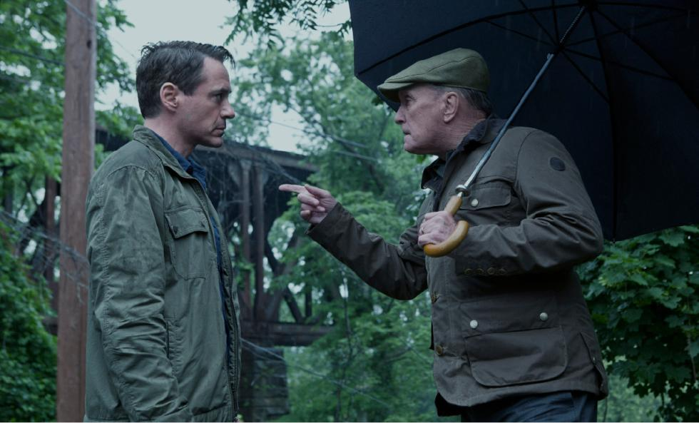 "(Warner Bros. photo/Claire Folger) Robert Downey Jr. and Robert Duvall appear in the first promotional still for the film ""The Judge,"" which filmed in the area last summer. Behind them can be seen the rainroad trestle near Cheapside at the Greenfield, Deerfield border."