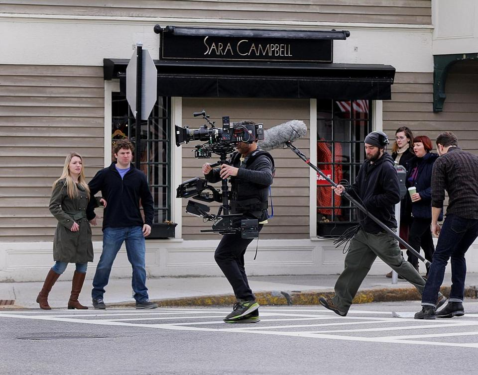"Cast and crew from ""Tumbledown"" took over a street in downtown Concord while filming an outdoor scene in April. (Wendy Maeda/Globe Staff /file)"