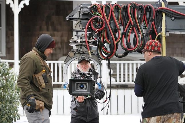 The film camera crew readies a camera on a boom for elevated shots along Ocean Street late Wednesday afternoon.(Wicked Local Staff Photo/Chris Bernstein)
