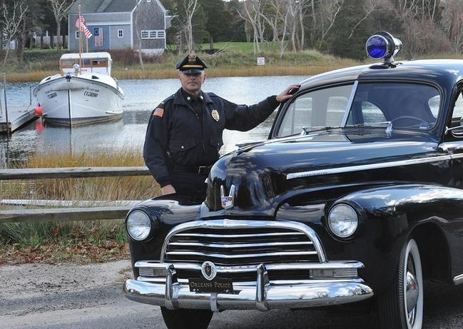 Orleans Police Lt. Kevin Higgins with the 1946 Chevy Cruiser tht helped in the rescue of the Pendleton. ( DAVID COLANTUONO/WICKED LOCAL STAFF PHOTO)