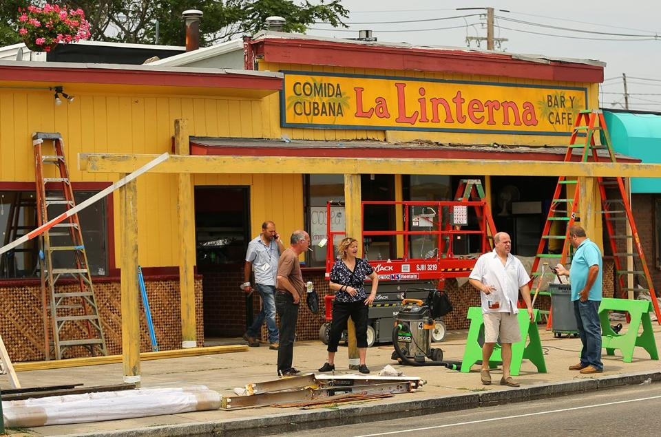 A pizza restaurant was made over into a Cuban cafe on Revere Beach Blvd. across the street from Revere Beach to transform the look of the beach into Miami Beach where a scene from the movie Black Mass will be filmed there for the next several days. (John Tlumacki/ Globe Staff)