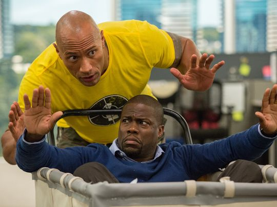 Dwayne Johnson (back) gets to be the funny one to Kevin Hart's straight man in 'Central Intelligence.' (Photo: Claire Folger)