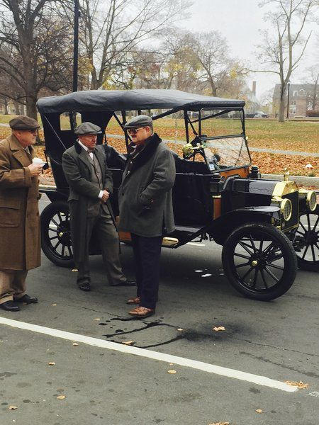 """(JILL HARMACINSKI/Staff photo) Actors in 1920s clothing gather around antique cars on Common Street in Lawrence during filming of the Movie """"Live by Night""""."""