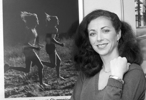 FILE - In this May 22, 1980 file photo, pioneer woman marathoner Kathrine Switzer stands in her New York office. In 1967, Switzer became the first woman to run with an official bib number in the Boston Marathon. A new film that captures much of the Boston Marathon's colorful history premieres Saturday, April 15, 2017, in conjunction with the 121st running of the race on Monday. (AP Photo/Suzanne Vlamis, File)