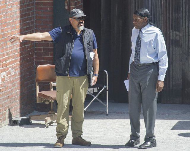 """(AMANDA SABGA/STAFF PHOTO) Actor Danny Glover, right, and Mark Little, first assistant director, speak on set of """"Proud Mary"""", a major movie being filmed in Lawrence"""