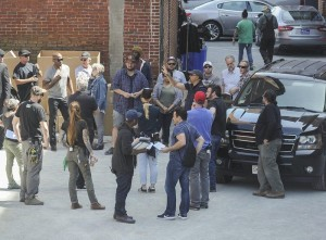 """(AMANDA SABGA/ Staff photo) The crew gathers for filming of """"Proud Mary"""" in Lawrence Tuesday."""