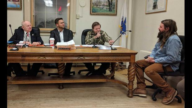 "Alex Berard, assistant location manager for Olive Avenue Productions, gave an update to the selectboard Wednesday on the end of ""Castle Rock"" filming in town. Berard reported that there are still two more days of filming left, slated for Tuesday, Dec. 19 and Wednesday, Dec. 20, weather permitting. Left to right -- Selectmen James Cornwell, Ryan Mailloux, and Richard Sheridan; and Berard. Photo by Jared Robinson"
