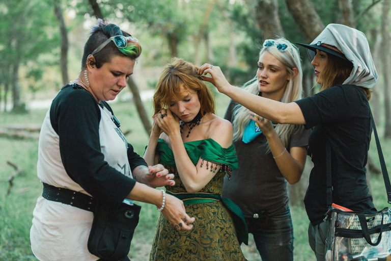 Crewmembers prep Stef Dawson (C) on the Oklahoma City set of Painted Woman. Photo by Priscilla Tran.