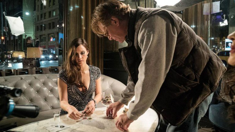 Aaron Sorkin setting the table for a scene from the Toronto-shot Molly's Game, starring Jessica Chastain. Photograph courtesy of STXfilms