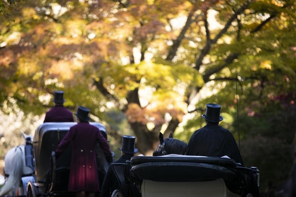 """Extras in horse-drawn carriages on the set of """"Little Women"""" in the Arnold Arboretum. (STEPHANIE MITCHELL/HARVARD STAFF PHOTOGRAPHER)"""