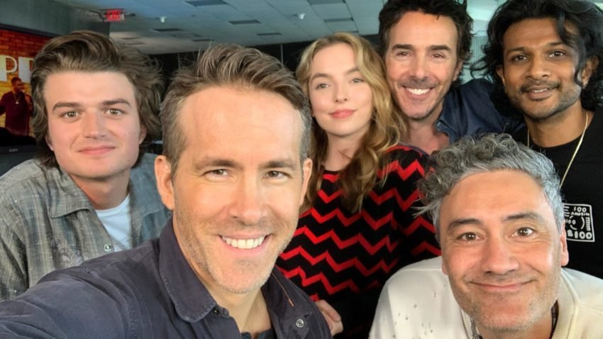 "The cast of the new film ""Free Guy'' includes (left to right) Joe Keery, Ryan Reynolds, Jodie Comer, ""Free Guy'' director Shawn Levy, Taika Waititi, and Utkarsh Ambudkar.	–20th Century Fox"